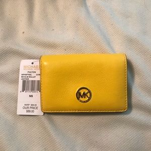 MK yellow wallet
